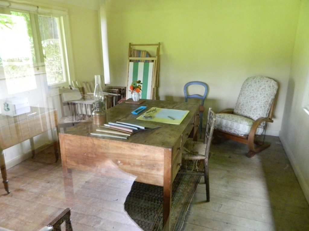 Inside Virginia's writing shed, her desk and spectacles just as she'd have left them.
